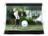 RORY MCILROY AUTOGRAPHED HOLDING THE FINISH PICTURE WITH RANGE DRIVEN BALL